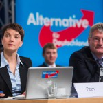 """HANOVER, GERMANY - NOVEMBER 28:  Co-leader Joerg Meuthen and chairwoman Frauke Petry sit on the podium during AfD (Alternative fuer Deutschland) federal party congress on November 28, 2015 in Hanover, Germany. The AFD aims to enter three new state parliaments in 2016 by luring conservative voters angry with Chancellor Angela Merkel's open-door asylum policy. This weekend the party will outline its plan to bring order to what it calls the """"asylum chaos."""" (Photo by Nigel Treblin/Getty Images)"""